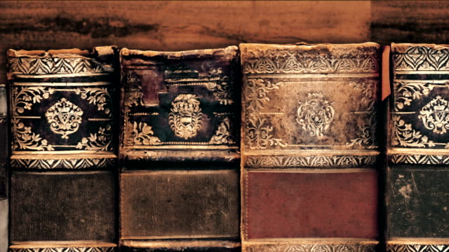 old books at library - antiquities stock videos & royalty-free footage