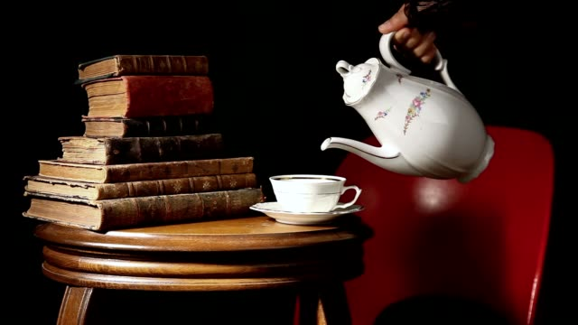 old books with tea