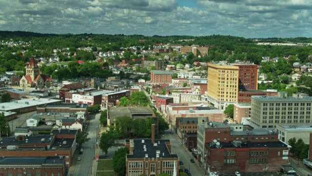 old brick buildings of uniontown, pennsylvania - drone shot - street name sign stock videos & royalty-free footage