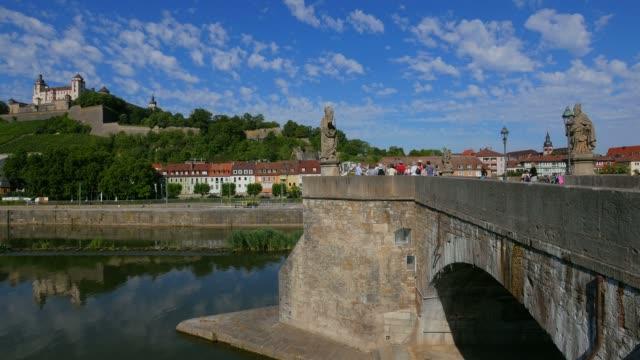 stockvideo's en b-roll-footage met old bridge across river main with marienberg fortress, wuerzburg, lower franconia, bavaria, germany - rond de 15e eeuw