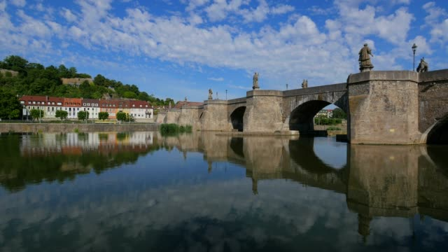 stockvideo's en b-roll-footage met old bridge across river main, wuerzburg, lower franconia, bavaria, germany - rond de 15e eeuw