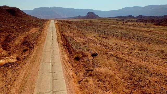 Old broken desert road. Aerial panoramic view