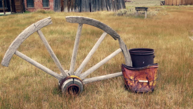 old, broken wagon wheel in bodie - california gold rush stock videos and b-roll footage