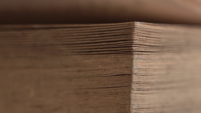 old brown book flip turning page in stack - textbook stock videos & royalty-free footage