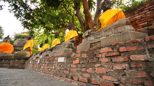 old buddha statues at historical park of ayutthaya, thailand - crane shot stock videos & royalty-free footage