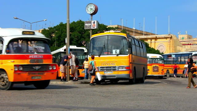stockvideo's en b-roll-footage met old buses at the main city terminus - valletta