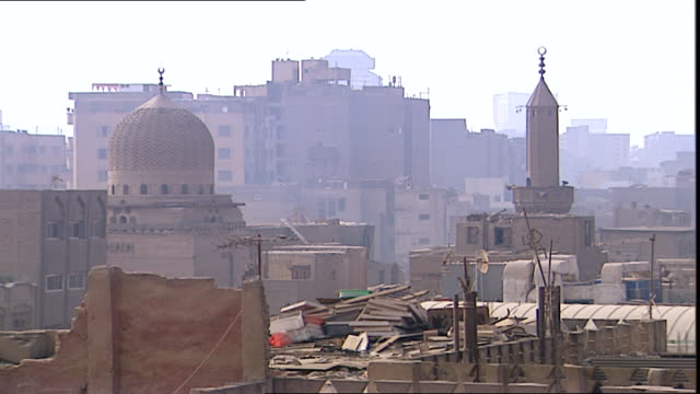 old cairo view of buildings cheek by jowl in old cairo taken from the base of the alhussein mosque minaret - panoramic stock videos & royalty-free footage