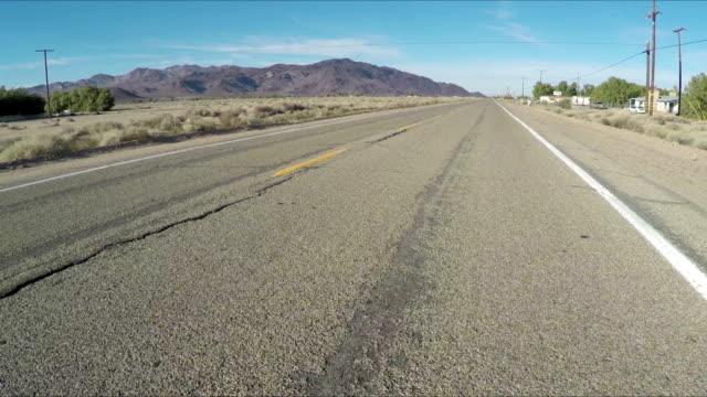 stockvideo's en b-roll-footage met oude auto op de nieuwe weg - 65 69 jaar