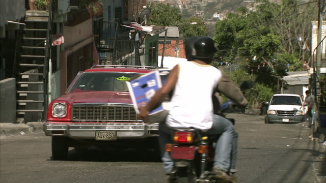 ws zo old car passing poor block of houses in federico quiroz / metropolitan district of caracas, miranda, venezuela - caracas stock videos & royalty-free footage