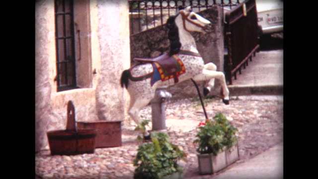 1971 old carousel horse in front of antique shop - carousel horse stock videos and b-roll footage