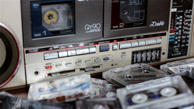 Old cassette tape recorder with cassettes.