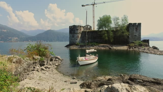 old castle on an island in a lake. - 40 seconds or greater stock-videos und b-roll-filmmaterial
