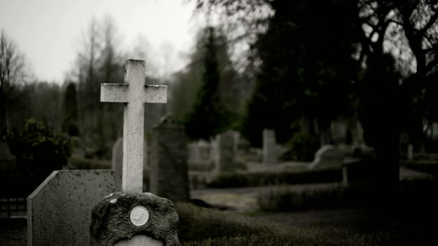 old cemetery with a holy white cross - cemetery stock videos & royalty-free footage