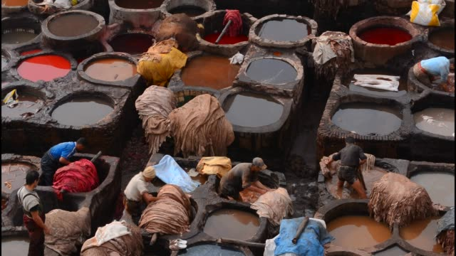 old chouara tannery which is almost 1000 years old in fez morocco - bottich stock-videos und b-roll-filmmaterial