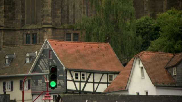 ms td old church and street with bus approaching / marburg, germany - ヘッセン州点の映像素材/bロール
