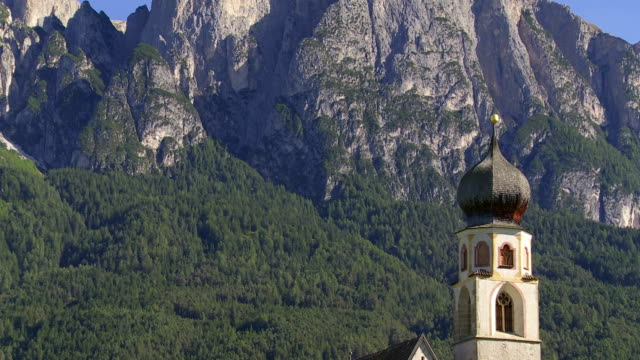 old church in front of alpine mountain tilt up - steeple stock videos & royalty-free footage