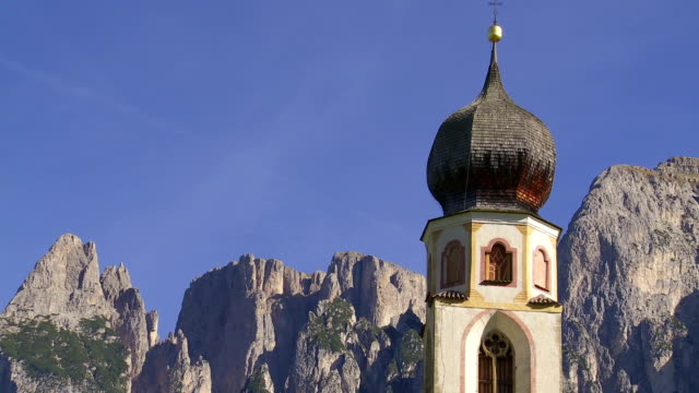 old church in front of alpine mountain pan - top garment stock videos & royalty-free footage