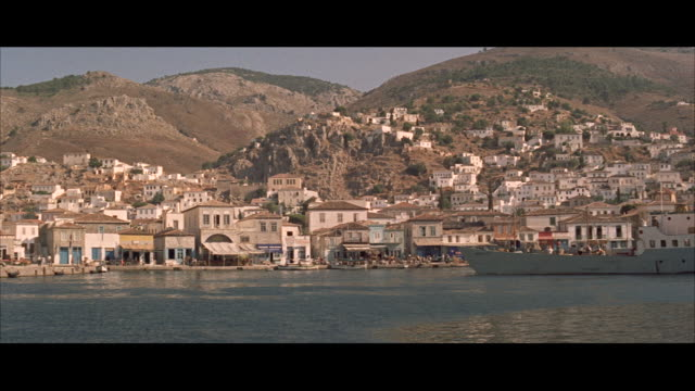 ms pov old city built on mountainside boats in sea harbour - breitwandformat stock-videos und b-roll-filmmaterial