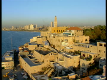 aerial ws old city of jaffa and skyline of tel aviv, dan metropolis, israel - ジャファ点の映像素材/bロール