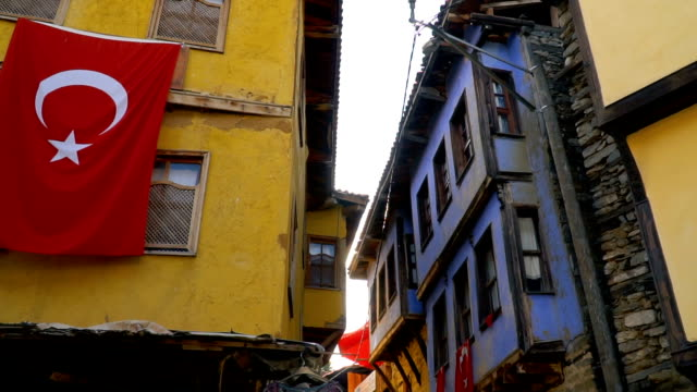 old colored wooden houses at cumalikizik,turkey - stone house stock videos & royalty-free footage