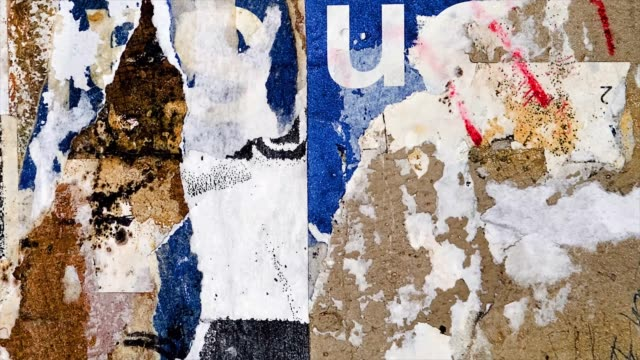 Old colorful posters ripped torn crumpled paper abstract grunge texture wall backdrop placard surface. Seamless loop collage urban street posters slideshow background