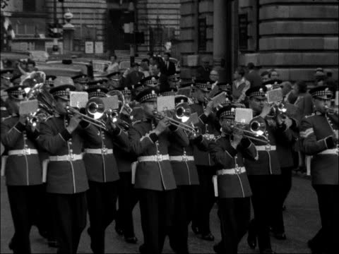 old contemptibles march in london england city of london ext shots of marching band along sot military veterans with flags along ditto past zoom in... - lord mayor of london city of london stock videos & royalty-free footage
