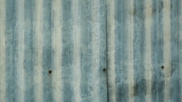 old corrugated zinc sheet with dirty and rust texture background - fence stock videos & royalty-free footage