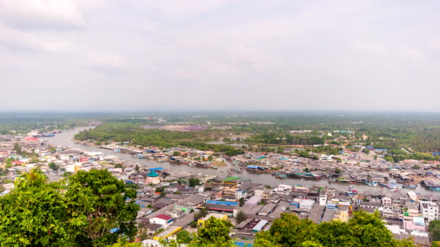 Old coummunity near harbor and moving ships activity, Chumpon, Thailand, time lapse video