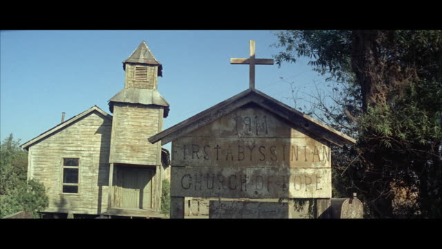 1967 ms old country church with sign first abyssinian church of hope in foreground - バプテスト点の映像素材/bロール