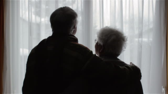 old couple in front of a window - husband stock videos & royalty-free footage