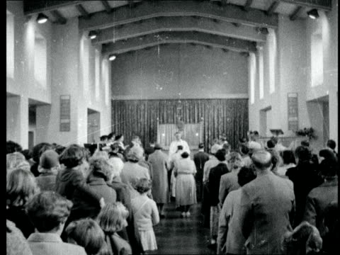 old couple's wedding england chingford essex church with tower st anne's ms int of church couple walk towards altar ms int of church taken from rear... - congregation stock videos and b-roll footage