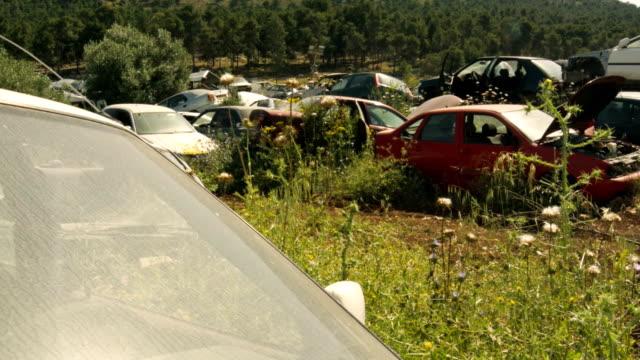 Old crushed cars at junkyard