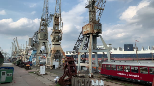 old dock cranes and a train carriage, port of hamburg - stationary stock-videos und b-roll-filmmaterial