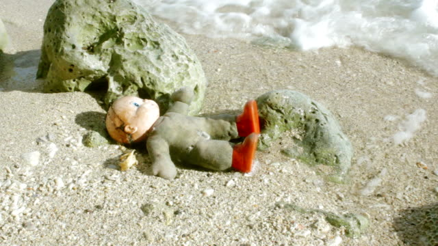 old doll swept by water at the beach - batangas province stock videos and b-roll footage