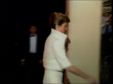 Old dresses of Princess Diana to be auctioned TX Princess of Wales into reception wearing high neck cream dress