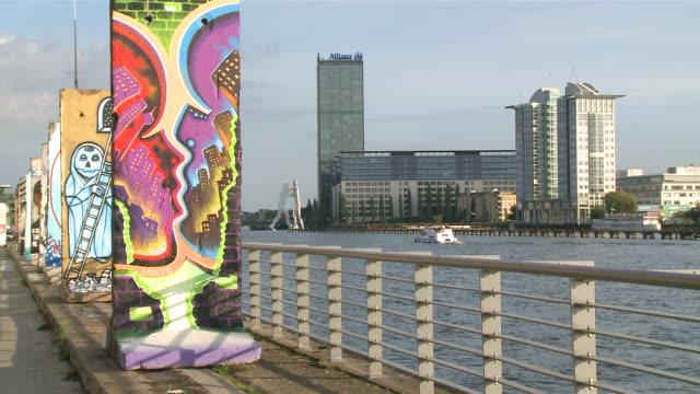 ms old east harbour on spree river with molecule men / berlin, germany - komplett stock-videos und b-roll-filmmaterial