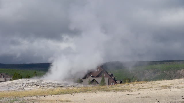 old faithful and yellowstone national park hotel - old faithful stock videos & royalty-free footage
