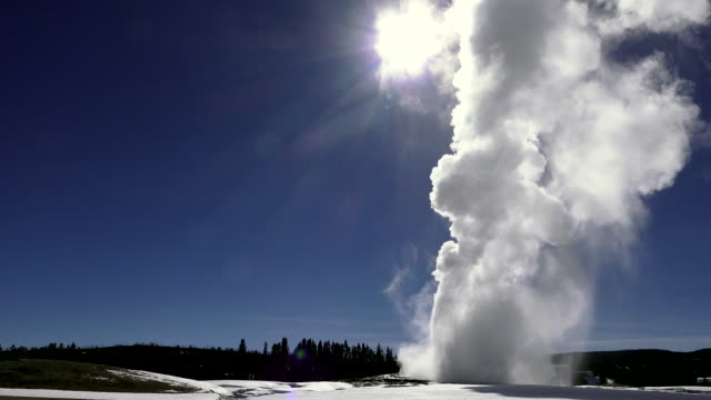 Old Faithful erupting, Yellowstone National Park, winter