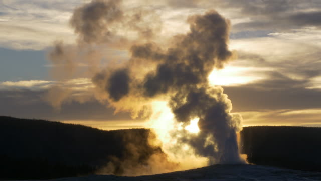 old faithful geyser eruption at sunset - geyser stock videos and b-roll footage