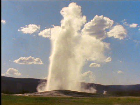 """""""old faithful"""" geyser spouting / yellowstone national park, wyoming - 2001 stock-videos und b-roll-filmmaterial"""