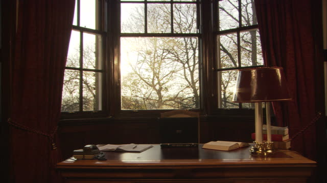 vidéos et rushes de ms, old fashion desk with window in background, england - bureau pièce