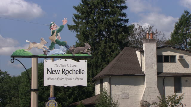 ms old fashion new rochelle welcome sign, house in background / new rochelle, new york, usa - welcome sign stock videos & royalty-free footage