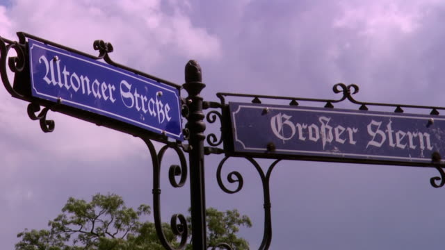 cu old fashion street name sign at grosse stern square / berlin, germany - street name sign stock videos & royalty-free footage