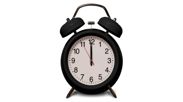 old fashioned black alarm clock rings at 12 o'clock on white background - alarm clock stock videos & royalty-free footage