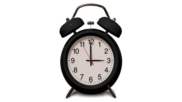 old fashioned black alarm clock rings at 3 o'clock on white background - number 3 stock videos & royalty-free footage