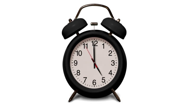 old fashioned black alarm clock rings at 5 o'clock on white background - number 5 stock videos & royalty-free footage