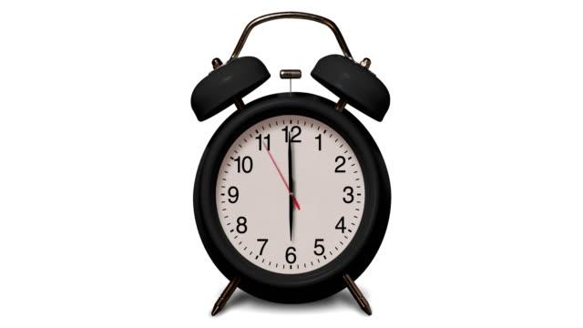 altmodische schwarze wecker klingelt bei 6 uhr auf weißem hintergrund - 10 seconds or greater stock-videos und b-roll-filmmaterial