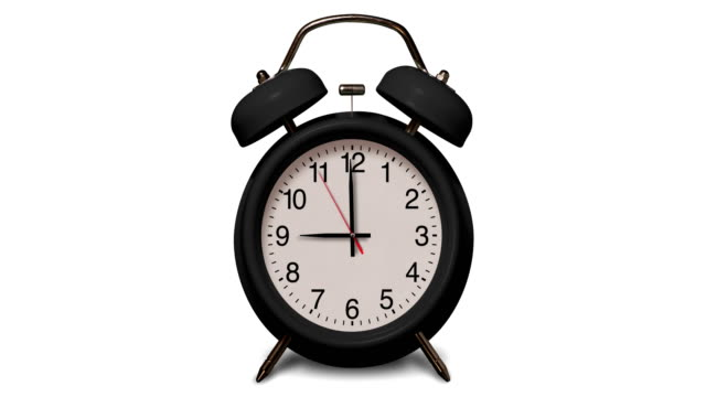 old fashioned black alarm clock rings at 9 o'clock on white background - second hand stock videos & royalty-free footage