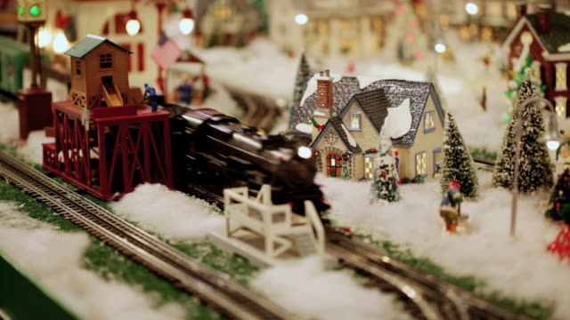 old fashioned christmas winter wonderland with toy train set (video) - village stock videos & royalty-free footage