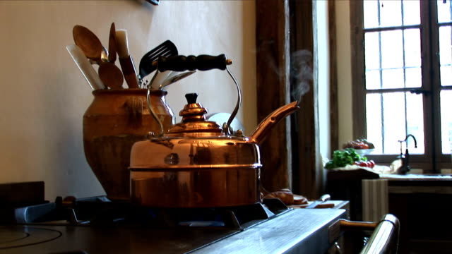 old fashioned copper teapot - tea pot stock videos and b-roll footage